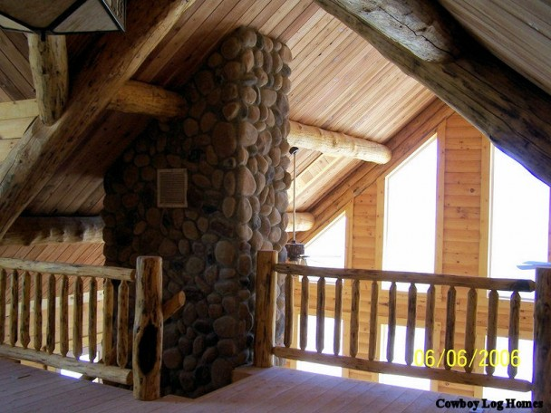 Open Loft with Handcrafted Log Accents