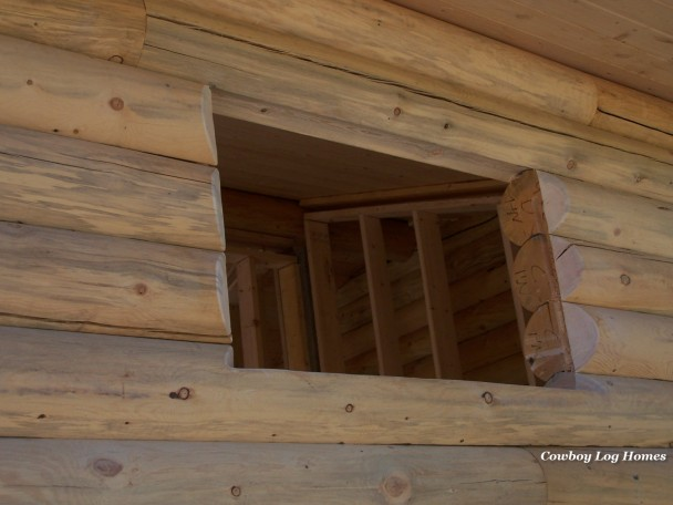 Bevel Cut Around Log Cabin Window Opening