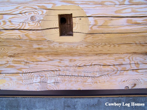 Outlet Box Hole Precut on Handcrafted Log Home