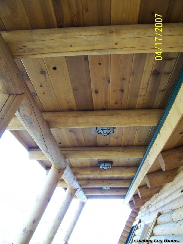 Covered Porch of Log Home with Post and Beam Work