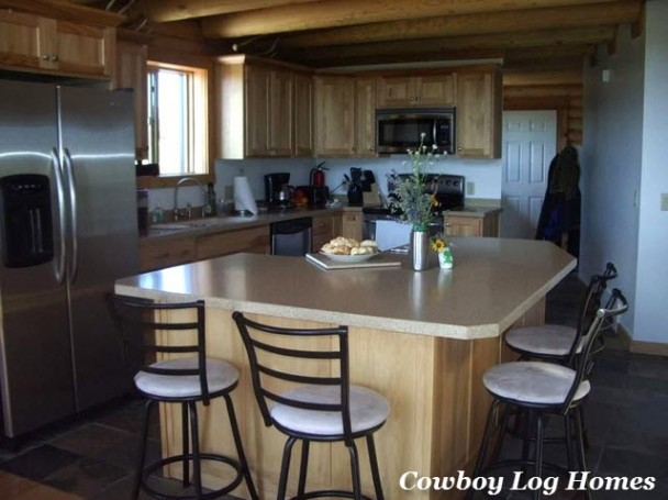 Log Home Kitchen with Breakfast Bar on Island