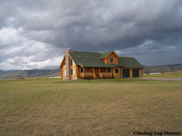 Log Home with Storm Brewing