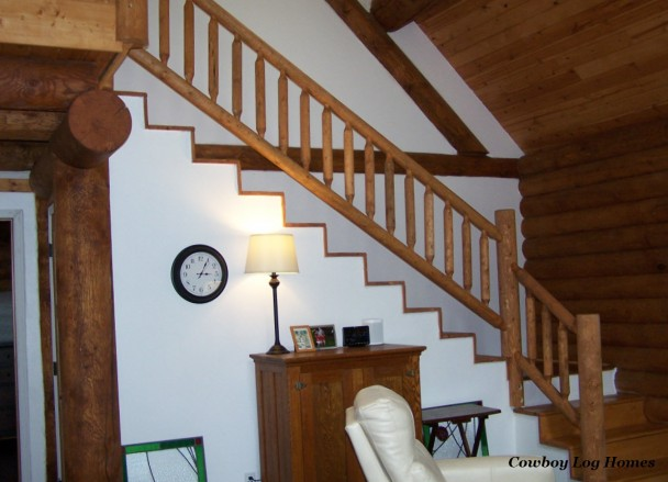 Interior Timber Staircase and Log Railing in Two Level Log Home