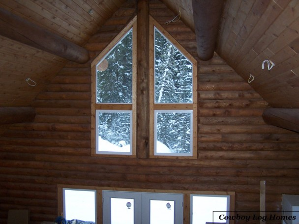 Interior of Stacked Log Gable End with Trapezoid Windows