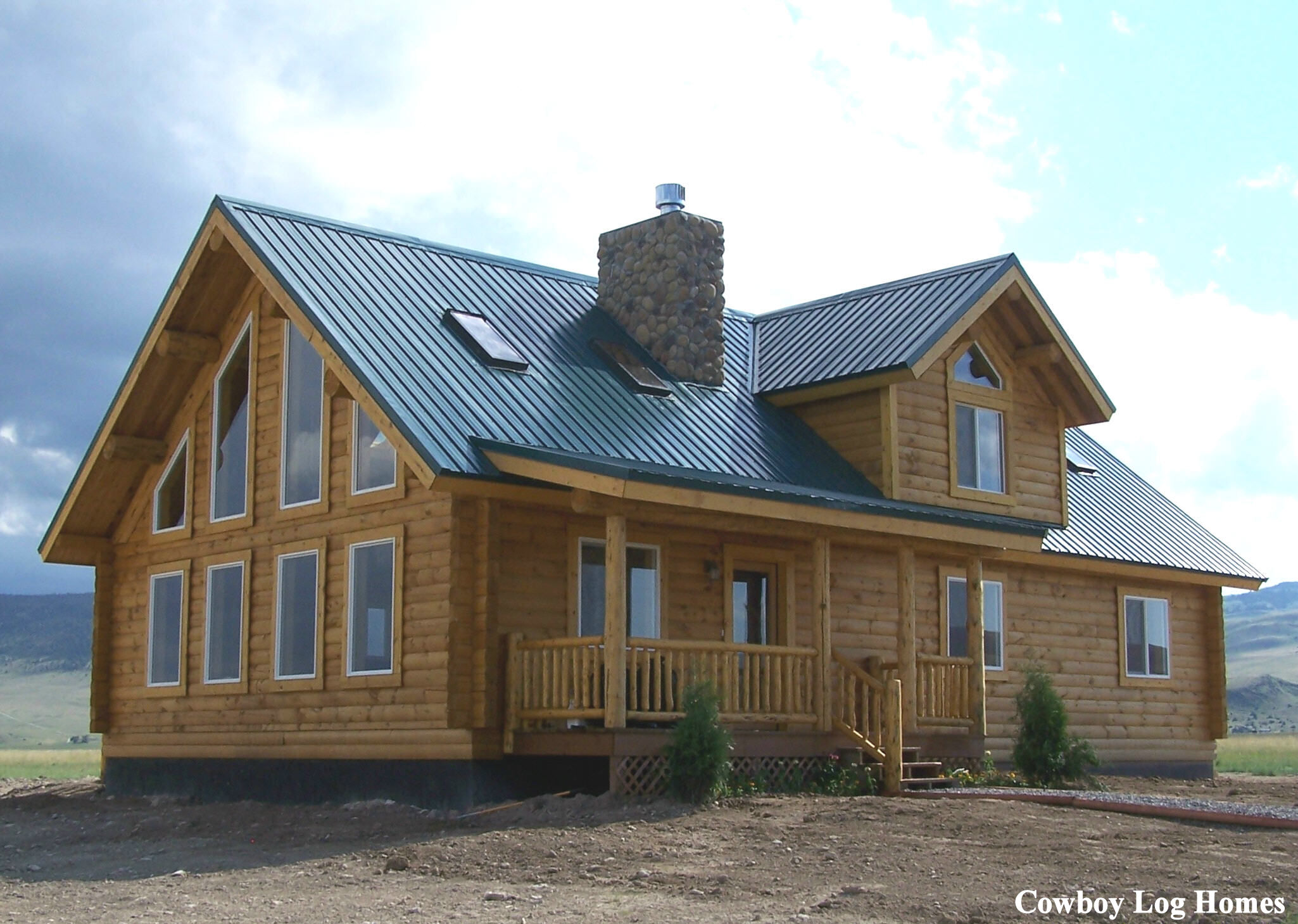 Luxury log homes western red cedar log homes handcrafted for Cost of building a house in montana
