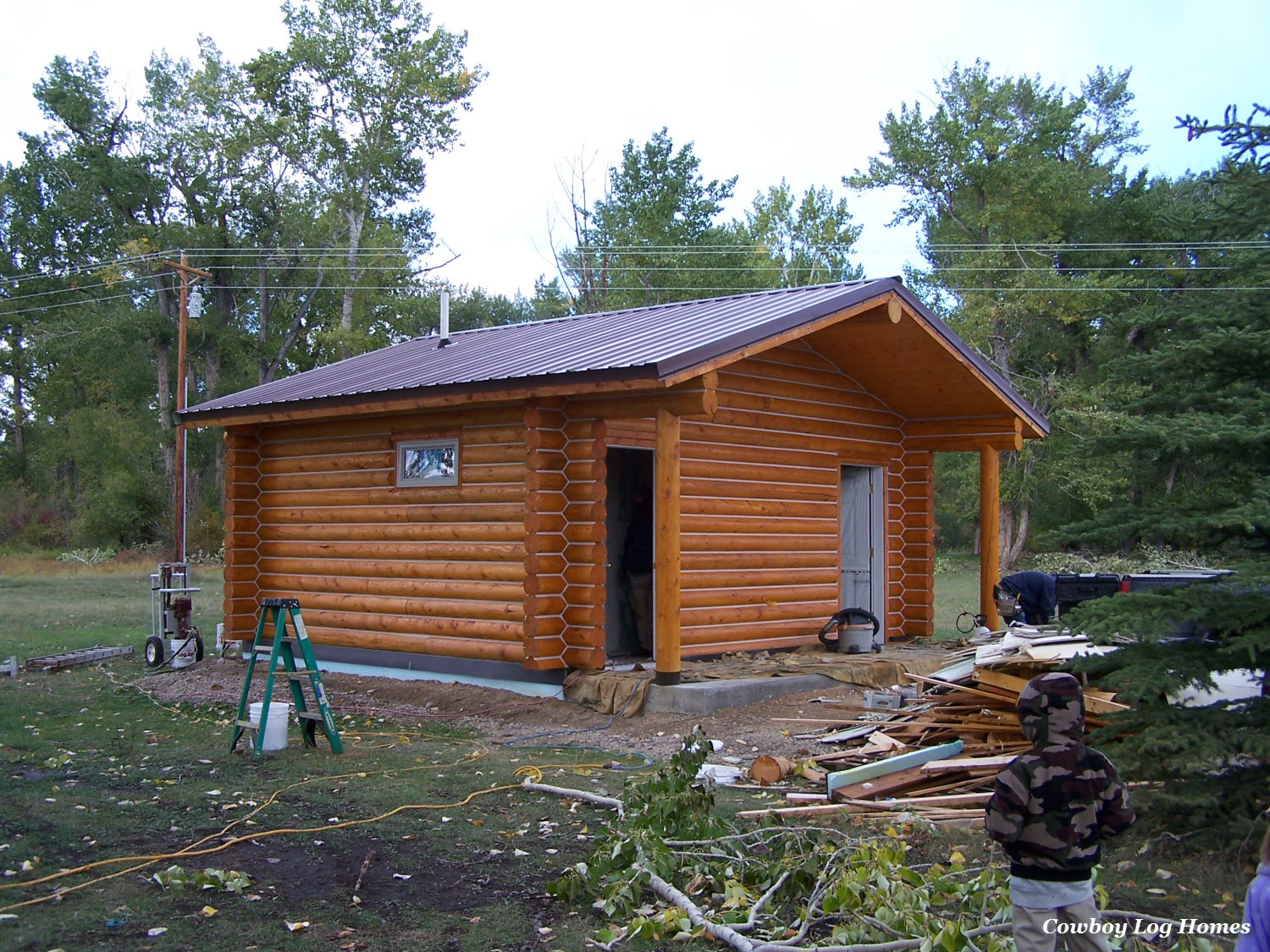 Small log cabins cowboy log homes for Small log cabin plans