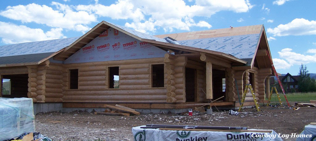 july 17th tar paper on garage and log home wing