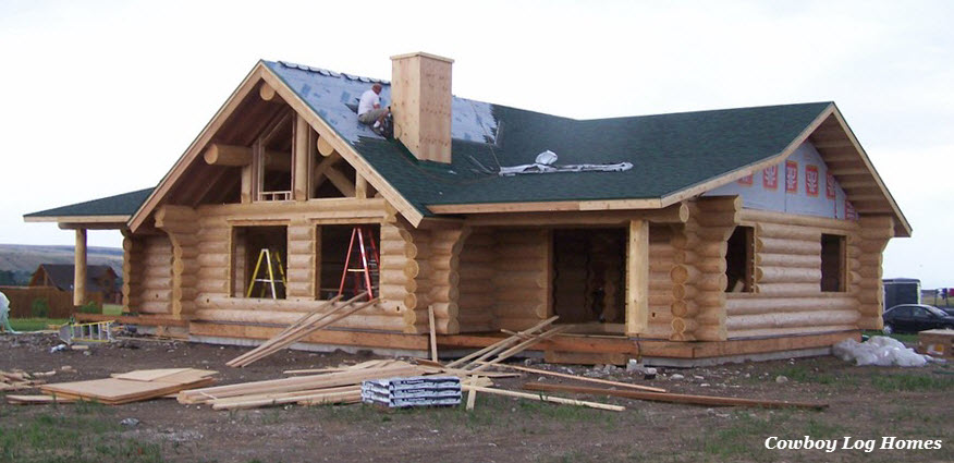 july 20th front of custom log home roofing finishing