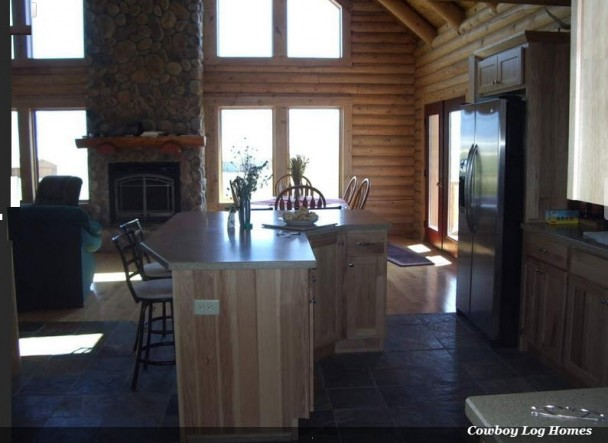 Swedish Cope log home kitchen and dining