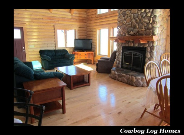 great room and fireplace of log home