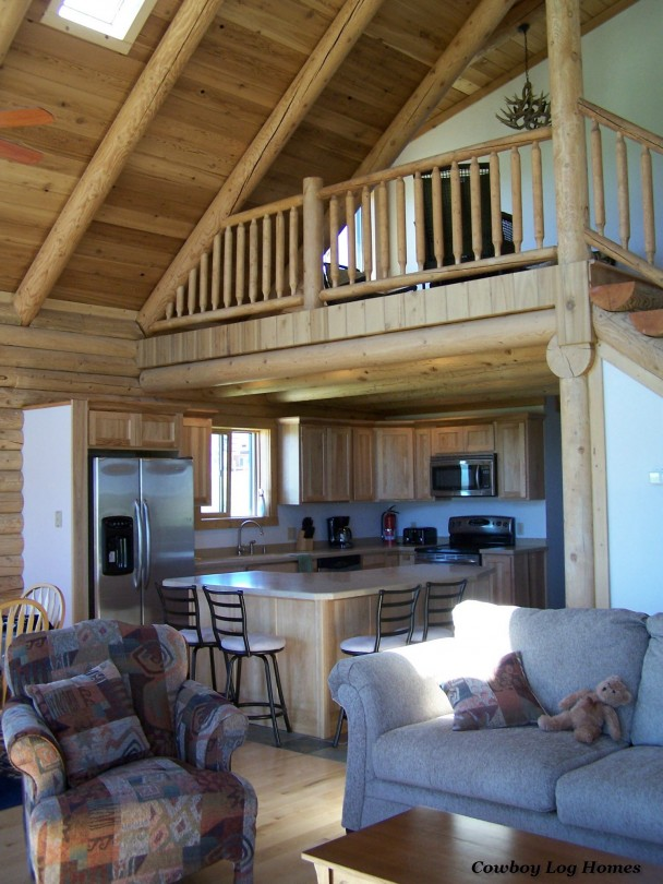 great room and kitchen in custom log homes